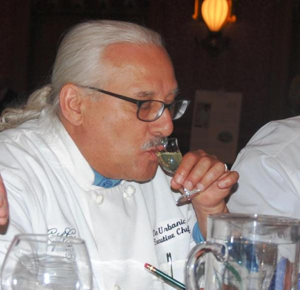 Chef Tim Urbanic, one of the Cast Iron Cook-Off judges, enjoying his sip of limoncello